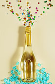 Sparkling wine bottle with shiny tinsel