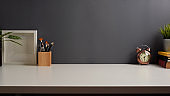 Workspace with study table with copy space, stationery, books and decorations