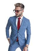 handsome businessman sticking one hand in pocket