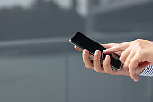 Close-up of man using mobile phone.