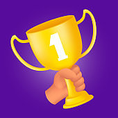 Human hand holding a golden trophy cup. 3D cartoon style vector illustration of the first rank winner award isolated on a violet background