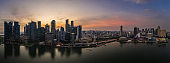Stunning sunset over the famous Singapore skyline by the Marina Bay in Southeast Asia main financial center