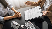 Real estate agent and customer discussing for contract to buy, get insurance or loan real estate or property.