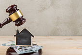 Real estate concept -auction gavel and little house with copy space