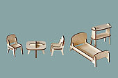Laser cut doll house furniture of plywood details isolated on green background