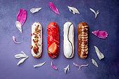 Tasty glazed eclair set, chocolate, strawberry, nuts, cream