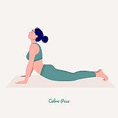 Cobra PoseYoga pose. Young woman practicing yoga  exercise.