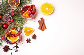 Christmas mulled wine and Christmas tree branches on a white background. Flat lay style