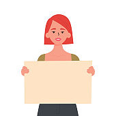 Girl holding a blank poster with place for text