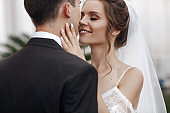 Bride and groom in wedding dress outdoors on celebration day