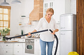 Woman making telescopic tube assembly of vacuum cleaner