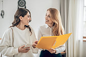 Young woman talking with a real estate agent about renting an apartment and looking involved