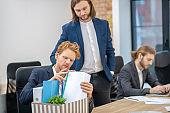 Men in formal suits working in office