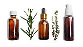 Dropper bottles with oil and herbs isolated on white background flat lay view. Herbal cosmetics concept