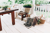 Cozy veranda with bench and flowers