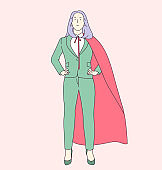 Business career growth and leadership concept. Successful business woman or girl office worker in suit and red cape.