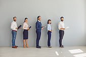 Group of young confident business people are waiting for an interview for a new job.