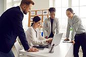 International company team having brainstorm in office concept