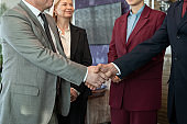A few business people shaking hands