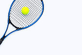 Tennis racket with ball on white.