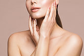 Woman Beauty Treatment, Model Touching Perfect Clear Face Skin, Beautiful Girl Makeup Close up, Skincare. Beige Background