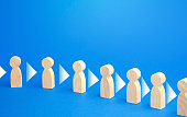 Figures of people stand in a row and consistently convey information to each other. Chain reaction, spread of information and rumors exchange. Partnership, unity, assistance. Interaction of persons.