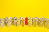 Red man in a crowd. Stranger, eye-catching. Different, special. Infected carrying threat of pandemic spread. Collective immunity. Social distance. Intruder detection. Coming out. Be different