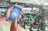 Hand holding smart phone with Diet Plan healthy eating,