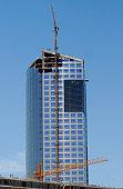 Construction crane in building industry