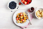 Breakfast with tiny pancakes and berries.