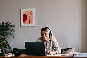 Happy Businesswoman Talking on Video Call Meeting with Colleagues During the Coronavirus Shutdown