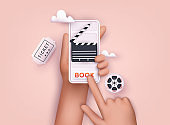 Concepts of online cinema ticket booking. Hand holding mobile smart phone with online book app. 3D Web Vector Illustrations.