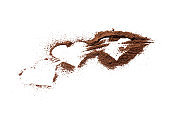 ground coffee powder isolated on white background. caffeine addiction concept. above view. coffee heart shapes cut out