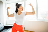 Young woman doing home workout in living room
