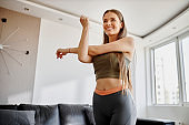 Young woman having home workout at her living room