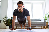 Man doing pushup exercise during home workout.