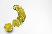 Trendy Color of the year 2021 Illuminating yellow. Fruit background. Sliced citrus fruit on a blue background. Flat lay, top view. Juicy ripe lime, lemon. Fruit pattern.
