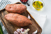 Sweet potato or batat with spices on white background