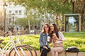Two young beautiful women friends outdoors
