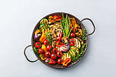 Grilled vegetables in a pan. Summer vegan plating, charcuterie