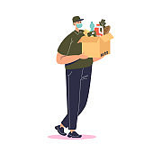 Courier wearing mask deliver food and grocery. Young delivery man holding box of products
