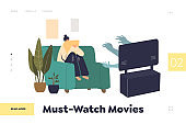 Watching must see movies on online streaming at home concept of landing page with woman at tv