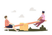 Kids on seesaw. Cute boy and girl on playground having fun together in seesaw