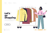 Shopping in store concept of landing page with woman choosing clothes on hanger