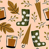 cute lovely autumn seamless vector pattern background illustration with umbrellas, leaves, candles, berries and boots