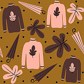 cute lovely autumn season seamless vector pattern background illustration with umbrellas, leaves, sweathers and dots