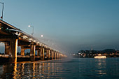 Banpo Bridge light and water show at dusk on the Han River in Seoul