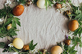 Easter rustic frame flat lay,  eggs and spring flowers on rustic linen. aesthetic holiday