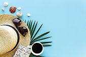 Travel, vacation concept. Hat, passport, eyeglasses, coffee on blue background