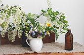 Beautiful spring wildflowers on rustic wooden table. Spring rural still life. Blooming flowers